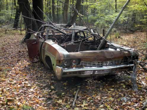 view of abandoned chevy impala