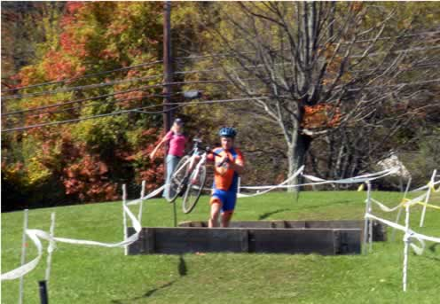 cyclist running over steeplechase obstacles