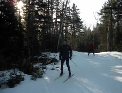 two skiers during warmup