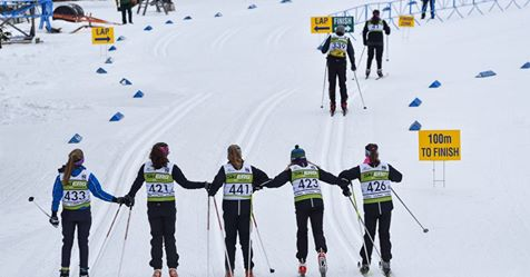 junior-girls-holding-hands-craftsbury-finish
